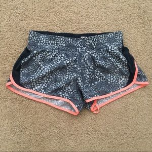 Nike navy and neon coral running shorts